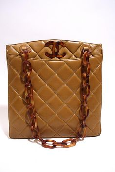 Mind Blowing Vintage CHANEL Light Brown Lambskin Tote Bag with Tortoise CC & Chain Strap. at Rice and Beans Vintage http://www.riceandbeansvintage.com