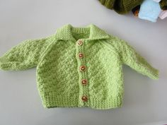 Our Knit & Natter Group Hand Knitted this lovely Green Baby Cardigan for sale.