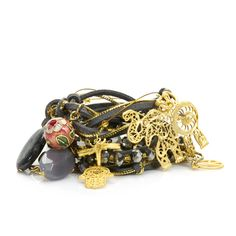 """Love this! Found it on stacias_pleasures Louise wraps charm around your wrist or necklace. How can you resist?  - 14K gold vermeil, hamsa charm, beads and crystals  - Fits most 6"""" to 7"""" wrists  - Convertible style, wear as a wrap bracelet or long necklace $58"""