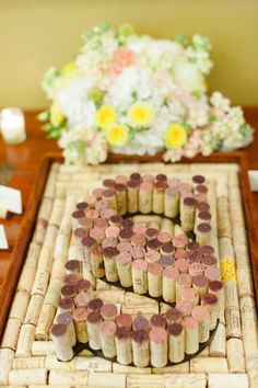 Wine cork initial as guestbook. Have guests sign the corks at the reception. Photography by stacyable.com, Floral Design by wallflowerdesigns.org