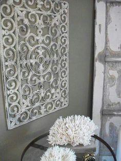 Rubber door mat painted & hung as wall art. Shabby sheek.