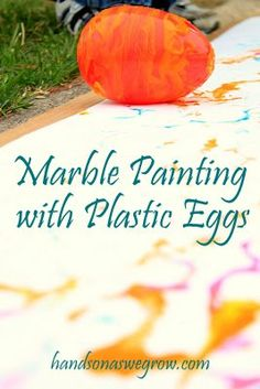 Marble painting with plastic eggs (and balls) -- Big art -- using movement to create art - all about the process. What have you used to do marble painting?