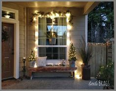 Christmas Porch--I like the lights and garland around the window with a few small lighted trees.