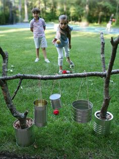 game from simple objects;  throw the objects into the cans (which can be gently swung for added difficulty)