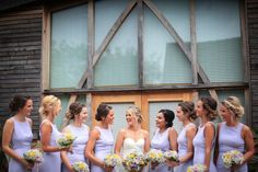 Bridal party of 9. Loose, romantic updo's