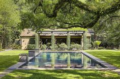 2 Longfellow Ln Houston, TX 77005: Photo Dappled sunlight provides both sun and shade around the pool & spa; pedestals with spillway fountains; air-conditioned Pool House; free-standing pergola with ceiling fans and vines trained to trellis provide welcome shade and a cool breeze in summer