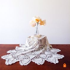 Pure elegance and classic charm.  This large vintage doily is now in the shop! Link in bio.