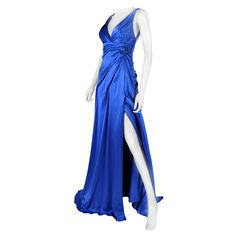 New VERSACE ROYAL BLUE SILK GOWN w/ METAL MESH ROSE   From a collection of rare vintage evening dresses at https://www.1stdibs.com/fashion/clothing/evening-dresses/