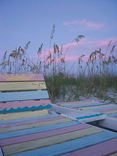 Colorful benches on the beach -sunset at Pass-A-Grille Beach.
