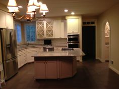 Janczuk- After. Shaker style cabinets in Pecan white, fridge box, and custom design glass doors #GreenKitchensUSA