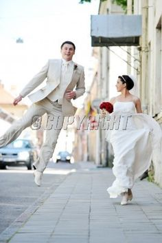 bride and groom  for an old brick wall