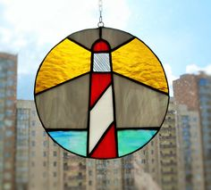 Stained glass suncatcher Rainy Night on the Lighthouse by caracoja on Etsy https://www.etsy.com/uk/listing/290984107/stained-glass-suncatcher-rainy-night-on