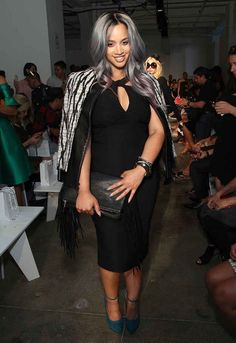 Dascha Polanco rock'n purple and blue hair with a  voluptuous black dress and beautiful teal shoes. #jacketonshoulders