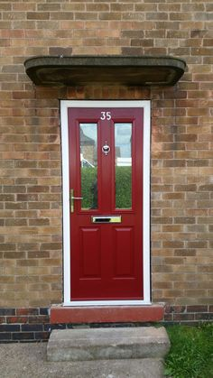 The popular Ludlow 2 @SolidorLtd  Composite Doors in red with chrome hardware and matching door numerals. Installed in Wollaton, Nottingham. For a free quotation call us on 01158 660066 visit www.thenottinghamwindowcompany.co.uk or pop into our West Bridgford showroom. #Nottingham #Bespoke #SOTM #Ludlow #Ideas #Home #Solidor #Wollaton #Chrome