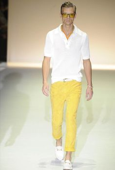Love the bright yellow trousers and the white sweater and shoes.