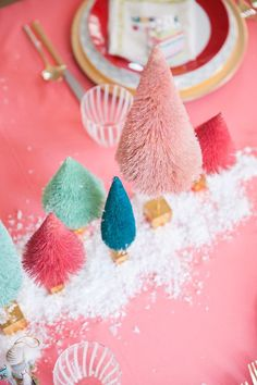 A whimsical Christmas table setting by coco+kelley complete with bottlebrush trees, pink souffles, glittering nutcrackers and a sprinkle of snow. Whimsical Christmas, Noel Christmas, Merry Little Christmas, Modern Christmas, Retro Christmas, Christmas Colors, All Things Christmas, Winter Christmas, Scandinavian Christmas
