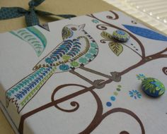 birdie magnet board--made from stove burner covered with fabric