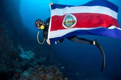"Captain Alberto Muñoz shows support for La Sele football team from the depths of Cocos Island, Costa Rica's ""Treasure Island"" located 300 miles off the Pacific coast. TICO TIMES  http://www.ticotimes.net/2014/06/29/costa-rica-has-fans-even-at-the-bottom-of-the-sea"