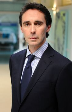 Guy Henry it is the way he glides Holby City's corridors...