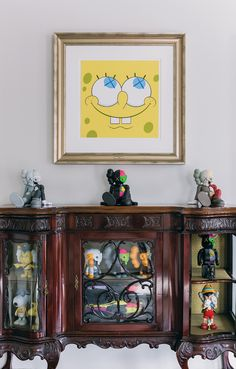 Additional art by KAWS on display, including the print Yellow Kawsbob, as well as figurines from the artist's companion Resting Place series.