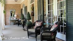 French country styled #porch with wicker and topiaries from Our Southern Home.