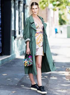 Wear your most flirty dress with a classic trench coat. Leave it open so you don't feel trapped by the heat and so everyone can admire the adorable dress underneath.