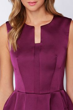 You can't beat a night when you're dressed to the nines in the Cameo Plexus Purple Satin Dress! A notched neckline tops a structured bodice and bell skirt. Purple Satin, Purple Dress, Dress Neck Designs, Blouse Designs, Frock Fashion, Fashion Dresses, Kurta Neck Design, Tank Top Outfits, Classy Outfits