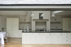 The Newcastle Shaker Kitchen by deVOL, Huge windows flood the space with natural light and bring the outside in.