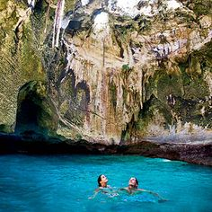 Fowl Cay, Bahamas Thunderball Cave is popular with snorkelers and swimmers. This rocky tidal cavern is reachable, during full tide, via a brief-but-pulse-quickening underwater passage. Inside, a grand, cathedral-like cavern greets you, suffused with an otherwordly blue-tinged light