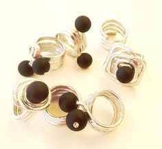 Rings, aluminium wire and wood beads