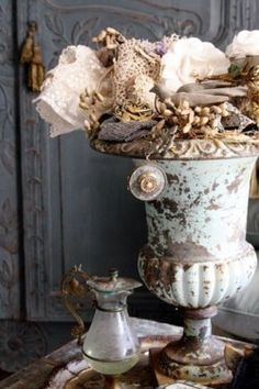 beach version of a planted urn, love the patina