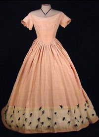 """Pink silk moire gown, c1848; """"In mid-century, skirts become even fuller with horizontal flounces or tucks added to the base skirt to give it even greater width and volume. Lines shifted from the vertical to the horizontal assisted by shorter, wider bodices. A new triangular, cone-shaped silhouette emerged featuring new pagoda sleeves."""""""