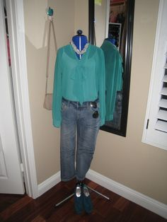 sheer green shirt, jeans and pearls