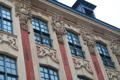 The black bullets in the facade are origin from world war II...Lille, France