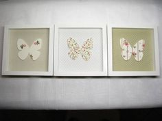 Lindos quadros em mdf com moldura tipo caixa, fundo revestido em tecido e aplicação de uma linda borboleta no centro. Perfeito decorar com delicadeza e suavidade o quarto do seu bebê. Pode ser feito em várias cores, estampas e tamanhos. Consulte-nos! VALOR REFERENTE A 1 QUADRO. R$ 49,00