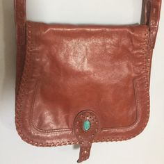 Rebecca Minkoff hippie boho saddle bag Genuine leather. Beautiful fun bag. Supppper hard to find. I've been holding onto it bc of that but I'm ready to pass it on to someone who will use it more! Great condition. Turquoise beetle type of stone on front.  Comes with dustbag Rebecca Minkoff Bags Crossbody Bags