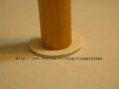 Evangelione.com has several miniature tutorials.  They're light on words, but they don't require fancy equipment.  Here, she cuts a circle of clay, then presses down on the centre with a dowel.  The sides are forced up on an angle (try rocking the dowel around) and you have a plate!