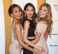 Chrissy Teigen, Lily Aldridge and Nina Agdal (l. to r.), who grace the cover of the Sports Illustrated 50th Anniversary 2014 Swimsuit Issue, strike their signature pose at the Sports Illustrated Swimsuit 50th Anniversary Party at Swimsuit Beach House on February 18, 2014 in New York.