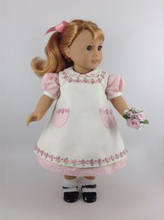 Handmade dress, pinafore, and petticoat for American Girl and other similar 18-inch dolls. Maryellen is modeling a 1950s dress with tiny