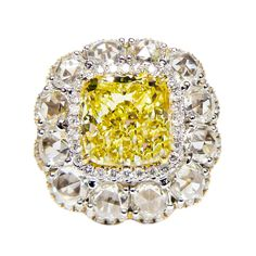 Cushion Cut Canary Diamond Ring | From a unique collection of vintage bridal rings at https://www.1stdibs.com/jewelry/rings/bridal-rings/