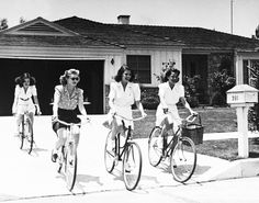 Cycling + Ladies. I love their cycling attire,  I wish I was riding during this ara .. Does a tricycle count ???  Or was this in the 40s when I was a twinkle in my moms eye??? . :)  so retro...so cute !!!