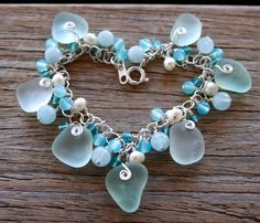 Soft and pretty sea shades sea glass bracelet handcrafted in sterling silver and accented with genuine aquamarine, chalcedony and apatite gemstone beads. Bracelet by OceanCharmsSeaGlass on etsy.