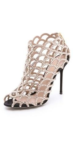 From Most Wanted: Rock the Look: Ten Visionary Styles Inspired by Musicians  Sergio Rossi crystal lattice booties, $1,670