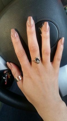 + Ideas for Coffin Shaped Nails to Rock This Summer medium length nude coffin nails, on a hand with outstretched fingers, and two golden rings, resting on a black steering wheel of a car Beige Nails, Nude Nails, Fall Nail Designs, Acrylic Nail Designs, Art Designs, Winter Nails, Summer Nails, Acrylic Nails For Summer, Coffin Shape Nails