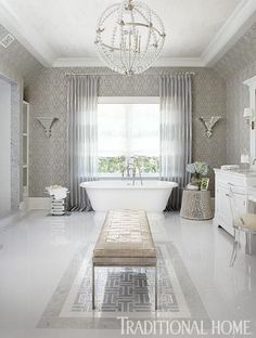 Glamorous elements assemble in this perfectly posh bathroom, but we think the crystal-beaded chandelier steals the show. - Traditional Home ® / Photo: Werner Straube / Design: Michael Mariotti