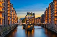 The famous Wasserschloss in the Speicherstadt in Hamburg, Germany. This is probably the most iconic spot in Hamburg among photographers, not difficult to see why. I hope you like my version of it. Hamburg Poster, Cologne, Europe Bucket List, Budget Planer, Hamburg Germany, City Architecture, Photo Wallpaper, Great View, Dusk