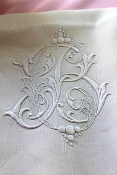 Monogram, embroidered, antique linen