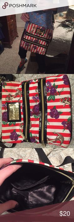 Betseyville crossbody Anchors, stripes, floral?! It can't get any better than that!! This purse has been well loved and has some wear on the exterior mostly. Just general fading. Could possibly be cleaned in the washer but scares me so I don't risk it! Priced accordingly but offers always considered Betsey Johnson Bags Crossbody Bags