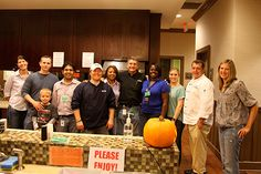 ACN employees volunteering at the Ronald McDonald House of Charlotte. Employees at ACN go to the house every month to cook dinner for the families.