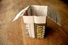 Origami newspaper seedling pots. Absolutely genius - and no need to go buying plastic pots for your plants